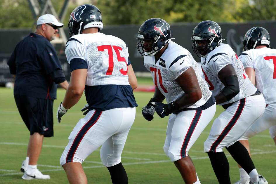 Houston Texans offensive tackles Matt Kalil (75) and Tytus Howard (71) run a drill during a joint training camp practice with the Detroit Lions at the Houston Methodist Training Center on Houston, Wednesday, Aug. 14, 2019.
