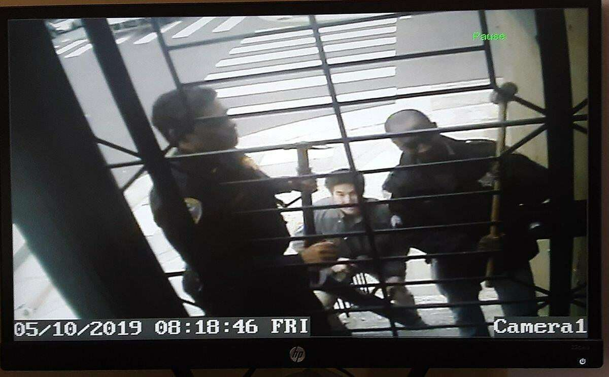 Security video shows San Francisco police executing a search warrant at the home of Bryan Carmody on Fri. May 10, 2019.