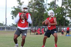 Atascocita quarterbacks Brice Matthews (left) and Gavin Session (right) working during a drill at practice.
