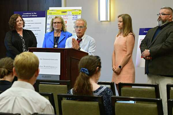 Attorney Jeff Anderson, center, announces 20 lawsuits filed against the Albany Diocese on the first day the Child Victims Act at the Hilton Albany on Wednesday, Aug. 14, 2019 in Albany, N.Y. Survivor Jeanne Marron, left, attorney Cynthia LaFave, second from left, and survivors Bridie Farrell and Mark Lyman stand at right. The act allows a one-year period for claims to be filed regardless of the age of the plaintiff. (Lori Van Buren/Times Union)