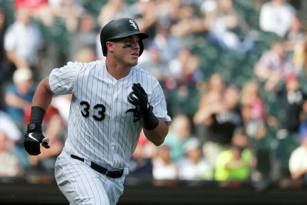 Chicago White Sox's James McCann watches his grand slam off Houston Astros relief pitcher Ryan Pressly during the eighth inning of a baseball game Wednesday, Aug. 14, 2019, in Chicago. (AP Photo/Charles Rex Arbogast)