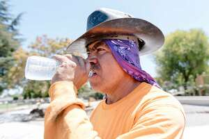Forman Roy Alvarado with Goodline Landscaping of Tracy takes a drink while working on a playground renovation in Livermore, Calif, on Wednesday, August 14, 2019. A high pressure area over the Bay area will trigger dangerous levels of summer heat and heat advisories have been issued for portions of Alameda, Contra Costa and other central valley counties.