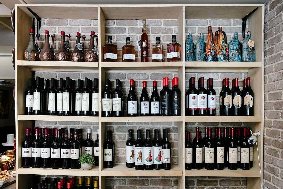 Georgian wines are seen behind the bar at Bevri restaurant in Palo Alto, Calif, on Tuesday, August 13, 2019.