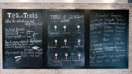 A chalkboard with Georgian wines, sayings, and tips for eating various Georgian foods is seen at Bevri restaurant in Palo Alto. Photo: Michael Short / Special To The Chronicle