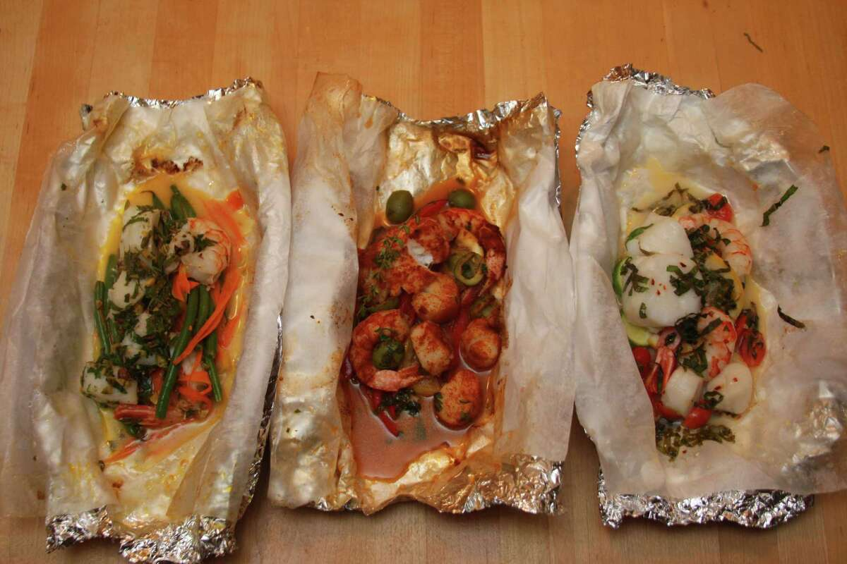 From left, the Moroccan, Spanish and classic fish dishes cooked in foil packets. (Photo by Paul Barrett)