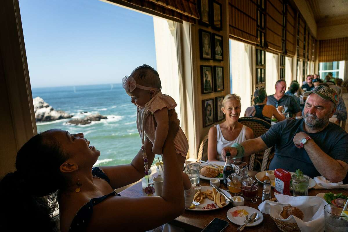A family has lunch at the Cliff House, in its landmark spot above the Pacific, in August 2019.