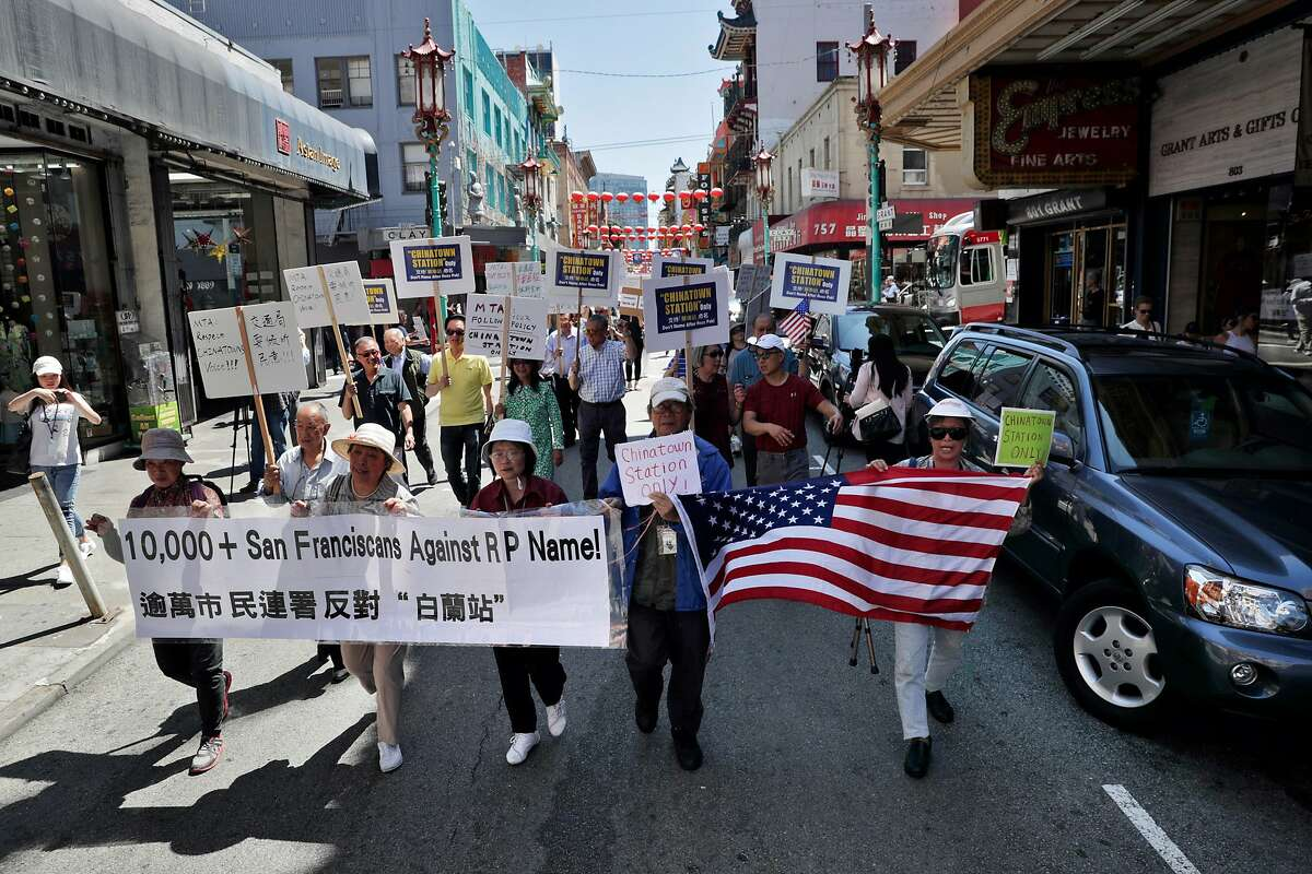 Local residents march on Grant Avenue in San Francisco, Calif., on Wednesday, August 14, 2019, as the Chinatown Merchants Association(CMA) held a public event to protest the proposal before the SFMTA to place Rose Pak's name on the Central Subway Chinatown station.