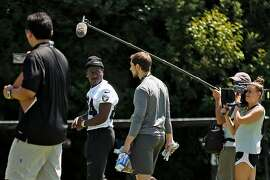 HBO's Hard Knocks documentary crew films Oakland Raiders wide receiver Antonio Brown (84) during NFL training camp on Tuesday, Saturday, July 27, 2019, in Napa, Calif.