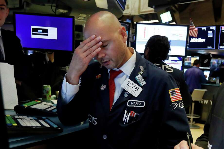 Specialist Mario Picone works on the floor of the New York Stock Exchange, Wednesday, Aug. 14, 2019. The Dow Jones Industrial Average sank 800 points after the bond market flashed a warning sign about a possible recession for the first time since 2007. (AP Photo/Richard Drew) Photo: Richard Drew / Copyright 2019 The Associated Press. All rights reserved