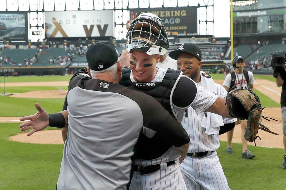 Chicago White Sox manager Rick Renteria hugs catcher James McCann after the team's 13-9 win over the Houston Astros after a baseball game Wednesday, Aug. 14, 2019, in Chicago. McCann earlier hit a grand slam in the eighth inning to give the White Sox the win. Photo: Charles Rex Arbogast, STF / Associated Press / Copyright 2019 The Associated Press. All rights reserved