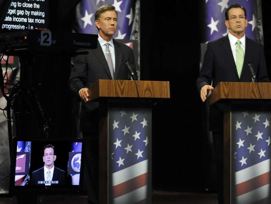 Democratic candidates for governor Ned Lamont, left, and Dan Malloy answer questions during a debate in Rocky Hill, Conn., Tuesday, Aug. 3, 2010. (AP Photo/Jessica Hill) Photo: Jessica Hill, AP / Associated Press