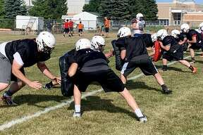 The Harbor Beach Pirates run drills during practice Wednesday afternoon.