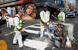 SFMTA workers painting stronger lines for pedestrian walkways on 6th Street at Stevenson, a corridor that has been the site of many pedestrian deaths. Vision Zero is the city's plan to reduce pedestrian and bicyclist deaths - but it's not working. Pedestrian deaths in particular have been on the rise in 2019.