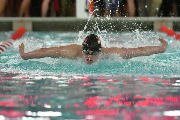 Patrick Colwell of the New Canaan Rams swims in the 200-yard individual medley at the FCIAC Swimming Championships on Thursday, Feb. 28, 2019 at Greenwich High School.