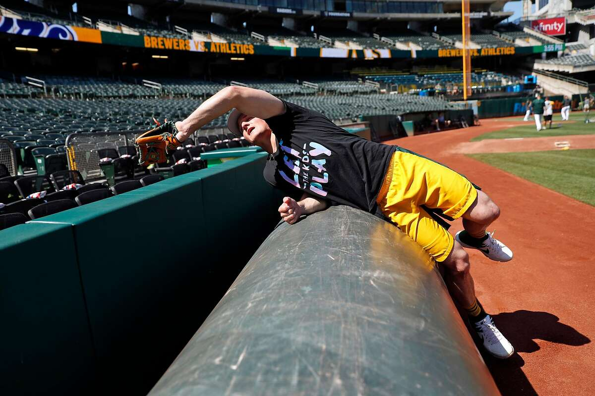 Oakland Athletics' third baseman Matt Chapman discusses the art of catching a ball near the tarp during a tour of foul territory at Oakland Coliseum in Oakland, Calif., on Wednesday, July 31, 2019.
