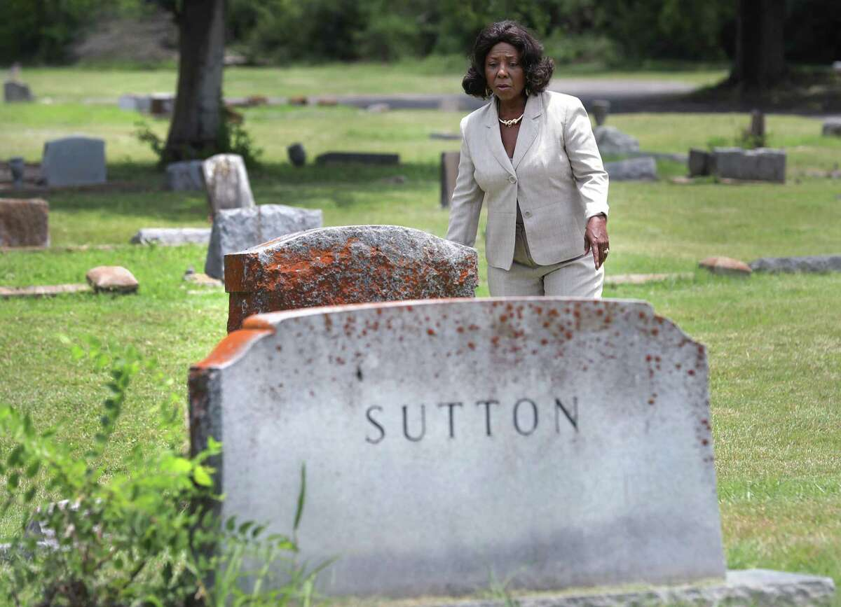 Vera Williams-Young visits the graves of the Sutton family in The Southern Memorial Eastview Cemetery. The cemetery, once over grown and in decay, is being restored to a sacred resting place that it once was. Vera Williams-Young, owner of Carter-Taylor-Williams Funeral Home, became the new curator and with the help of volunteers, has restored the burial ground to a place of honor that she remember visiting as a child.