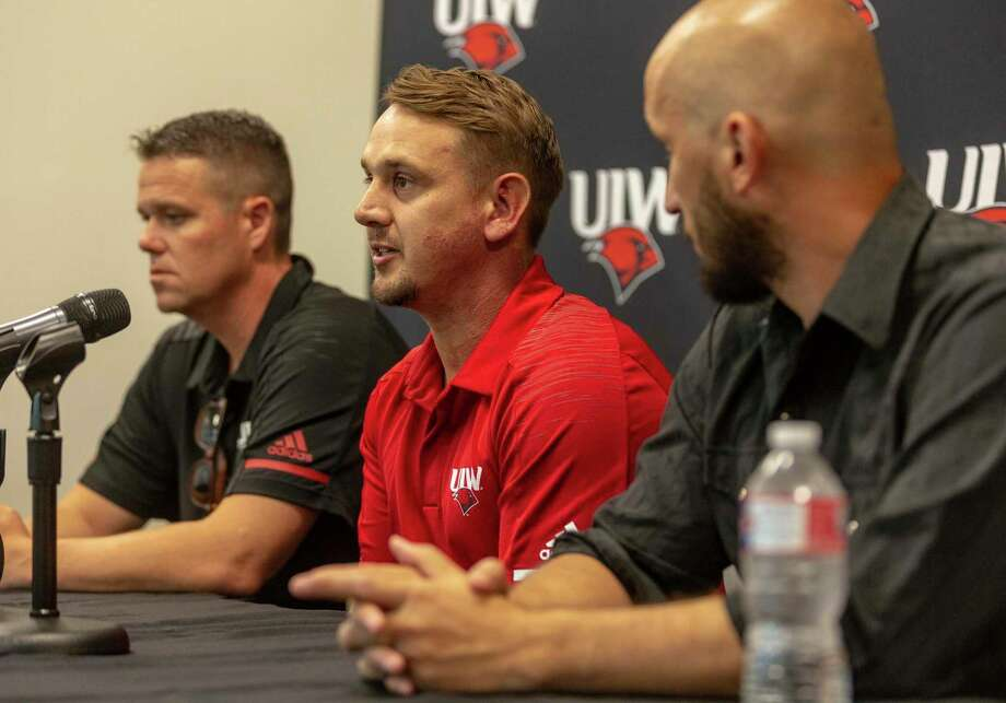 University of the Incarnate Word football coach Eric Morris, center, answers a question Wednesday, Aug. 14, 2019 during media day while flanked by offensive coordinator Cody Crill, left, and defensive coordinator Justin Deason. Photo: William Luther, Staff / Staff Photographer / ©2019 San Antonio Express-News