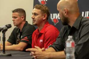 University of the Incarnate Word football coach Eric Morris, center, answers a question Wednesday, Aug. 14, 2019 during media day while flanked by offensive coordinator Cody Crill, left, and defensive coordinator Justin Deason.
