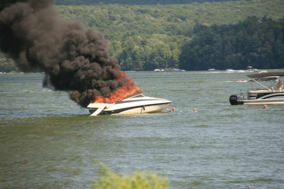 Tony & Cathy Ricciardi of Ravena, while at their family vacation at Lake Wallenpaupack in Pennsylvania saw this boat fire in front of the house. Everyone escaped OK, but the boat was destroyed.