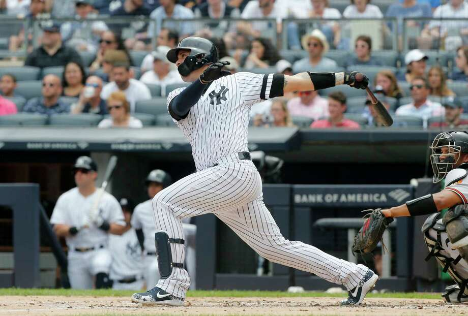NEW YORK, NEW YORK - AUGUST 14:   Gary Sanchez #24 of the New York Yankees follows through on his first inning three run home run against the Baltimore Orioles at Yankee Stadium on August 14, 2019 in New York City. (Photo by Jim McIsaac/Getty Images) Photo: Jim McIsaac / 2019 Getty Images