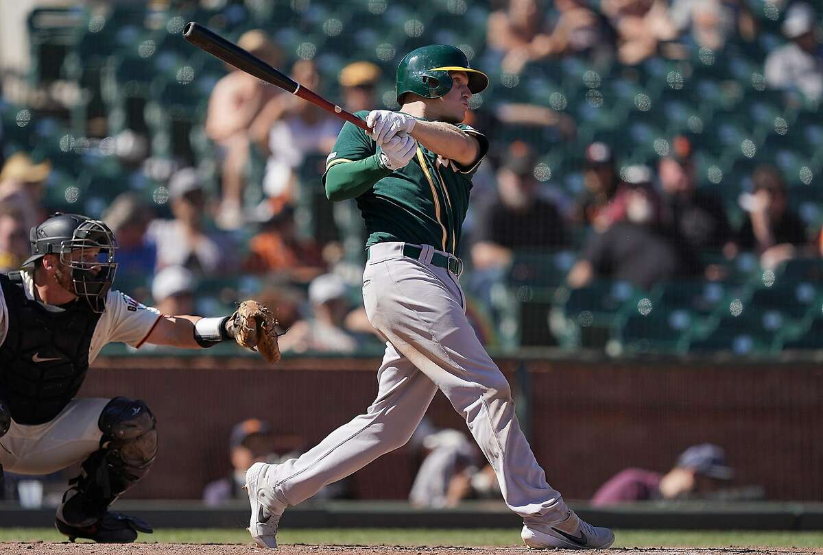 SAN FRANCISCO, CA - AUGUST 14: Corban Joseph #56 of the Oakland Athletics hits a sacrifice fly scoring Mark Canha #20 against the San Francisco Giants in the top of the ninth inning at Oracle Park on August 14, 2019 in San Francisco, California. (Photo by Thearon W. Henderson/Getty Images)
