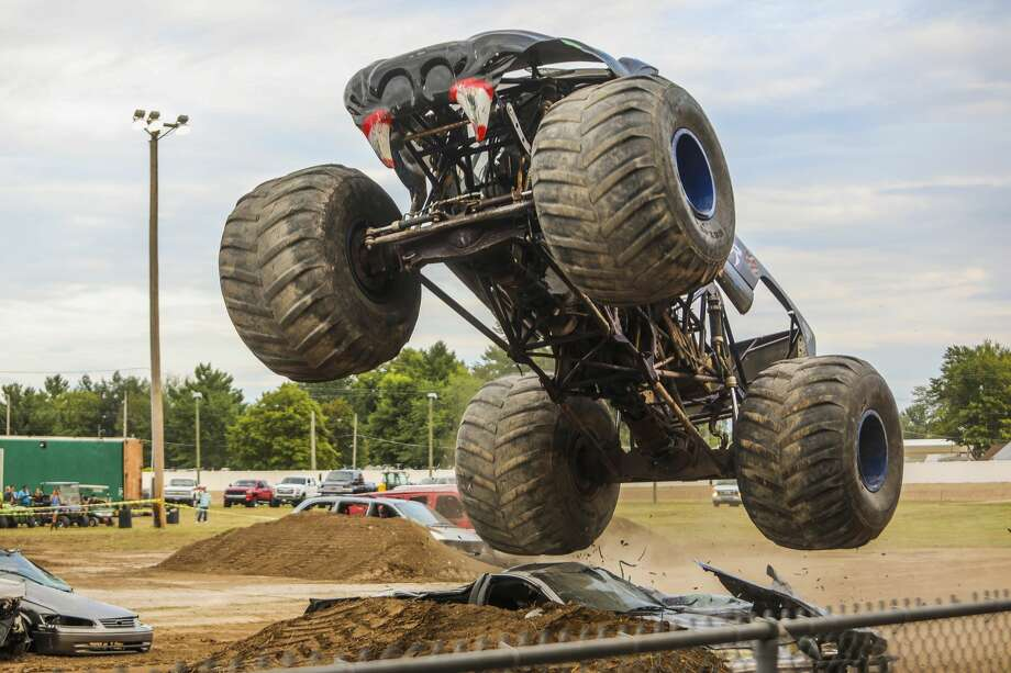 Monster truck drivers race around a track on Wednesday, Aug. 14, 2019 at the Midland County Fair. (Katy Kildee/kkildee@mdn.net) Photo: (Katy Kildee/kkildee@mdn.net)
