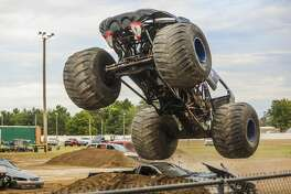 Monster truck drivers race around a track on Wednesday, Aug. 14, 2019 at the Midland County Fair. (Katy Kildee/kkildee@mdn.net)