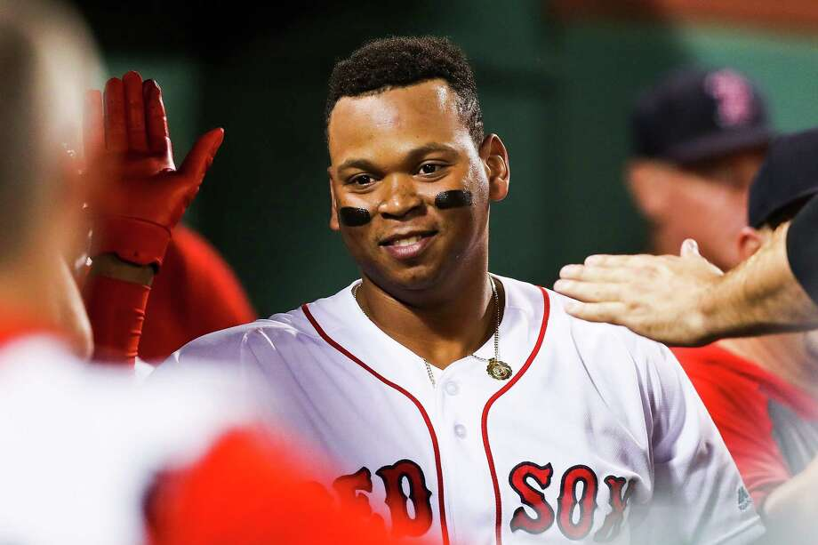 BOSTON, MA - AUGUST 05:  Rafael Devers #11 of the Boston Red Sox returns to the dugout after hitting a solo home run in the fifth inning of a game against the Kansas City Royals at Fenway Park on August 5, 2019 in Boston, Massachusetts.  (Photo by Adam Glanzman/Getty Images) Photo: Adam Glanzman / 2019 Getty Images