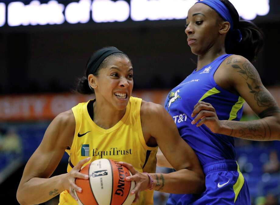 Los Angeles Sparks forward Candace Parker, left, drives to the basket against Dallas Wings' Glory Johnson, right, in the first half of a WNBA basketball game in Arlington, Texas, Wednesday, Aug. 14, 2019. (AP Photo/Tony Gutierrez) Photo: Tony Gutierrez / Copyright 2019 The Associated Press. All rights reserved.