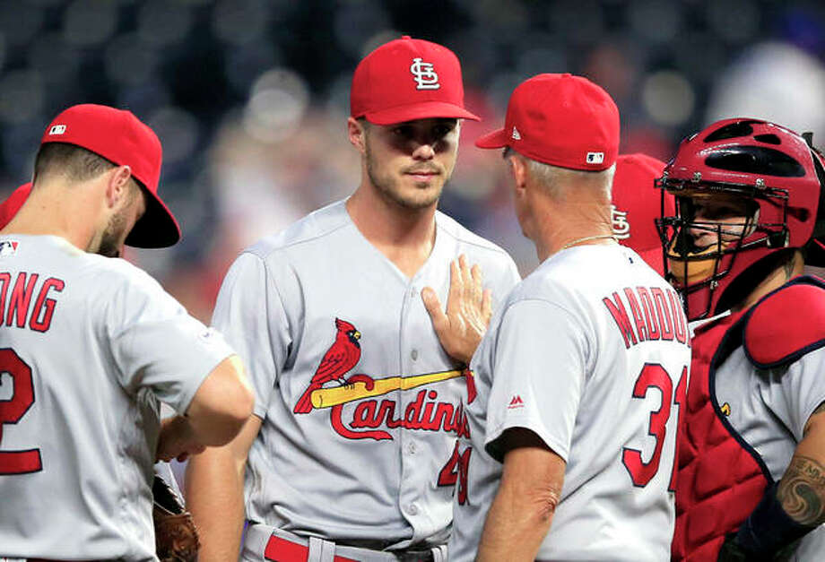 Cardinals starting pitcher Dakota Hudson, center, has a talk with pitching coach Mike Maddux (31) during the sixth inning of Wednesday night's win over the Kansas City Royals at Kauffman Stadium in Kansas City. Photo: AP Photo