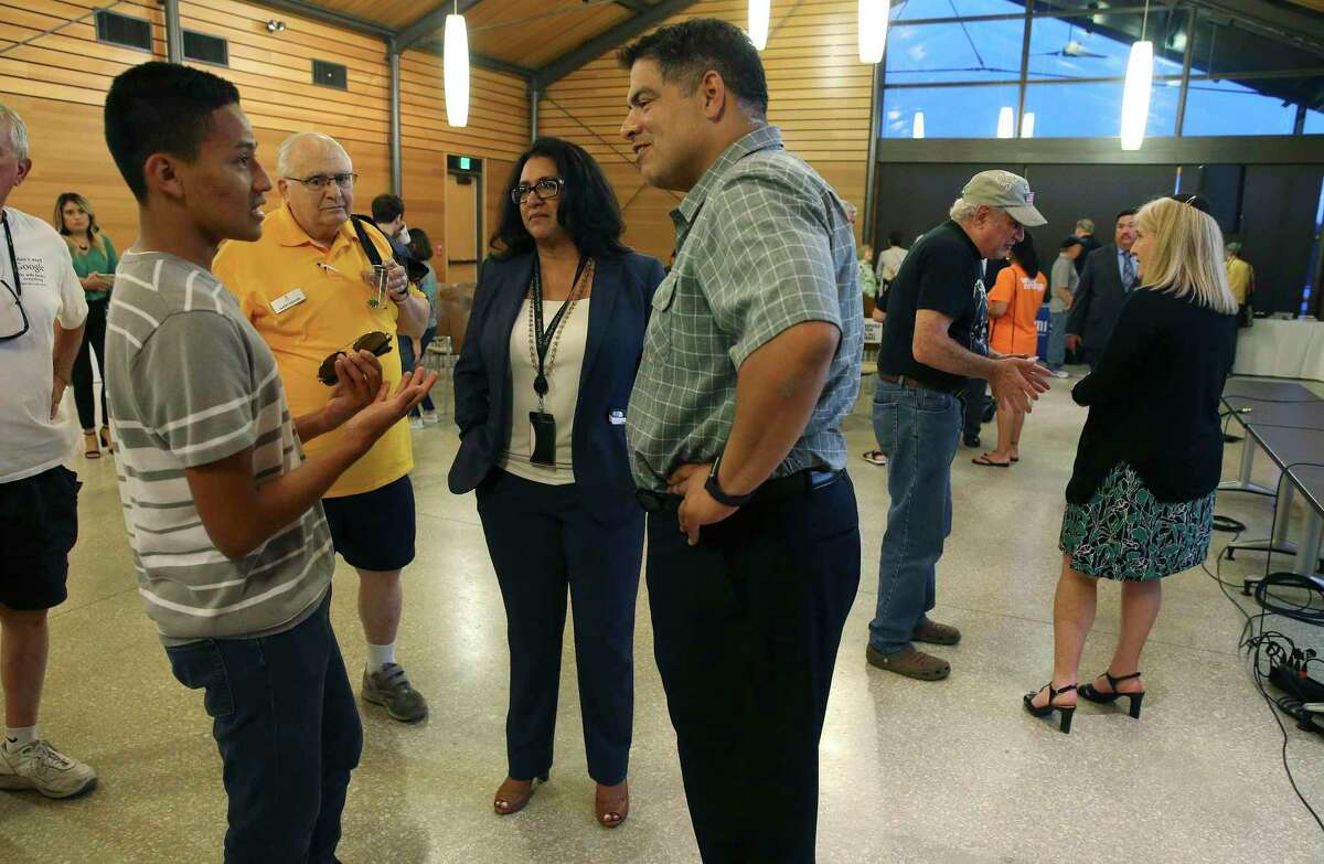 District 8 Councilman Manny Pelaez (right) meets with Manny Rodriguez, an El Paso resident and a student at St. Mary's University, after a community forum on Aug. 14, 2019, to discuss recent mass shootings, including one in El Paso. About 150 people attended the event at Phil Hardberger Park's Urban Ecology Center.