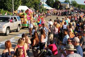 The Parade of Tropical Fools winds its way through a packed crowd in Caseville. Jimmy & the Parrots had a concert shortly after the parade finished.