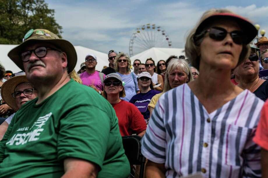Potential Iowa voters listen as Sen. Amy Klobuchar, D-Minn., 2020 Democratic presidential candidate, speak at the Iowa State Fair on Aug. 10, 2019, in Des Moines. Photo: Washington Post Photo By Salwan Georges / The Washington Post