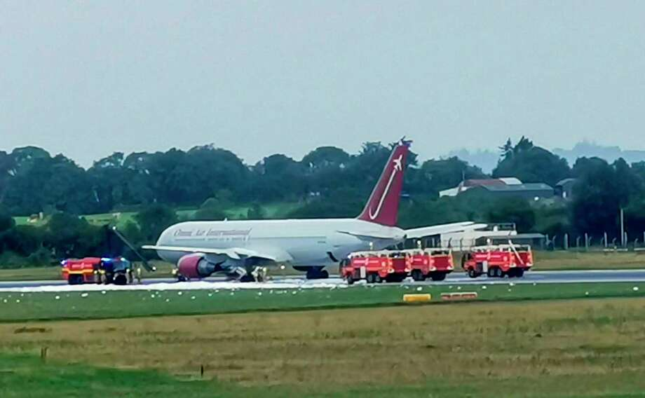 "A picture released to AFP courtesy of Jack O'Shea shows firecrews attending an Omni Air International aircraft on the tarmac at Shannon Airport in County Clare, mid-west Ireland, on August 15, 2019 after an incident. - Flights were suspended at Shannon Airport on August 15, 2019 after a fire broke out on the undercarriage of an aircraft on the runway, an airport spokesman said. (Photo by Jack O'SHEA / Jack O'SHEA / AFP) / RESTRICTED TO EDITORIAL USE - MANDATORY CREDIT ""AFP PHOTO / JACK O'SHEA "" - NO MARKETING NO ADVERTISING CAMPAIGNS - NO ARCHIVE - DISTRIBUTED AS A SERVICE TO CLIENTSJACK O'SHEA/AFP/Getty Images Photo: JACK O'SHEA, AFP/Getty Images / AFP"