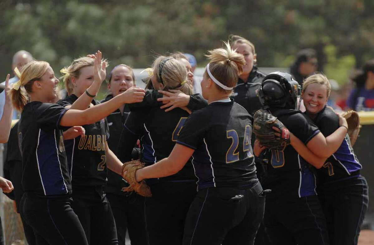 University at Albany women's softball team members celebrate their win over UMBC at the America East Championship tournament on Thursday, May 8, 2008. (Paul Buckowski / Times Union)