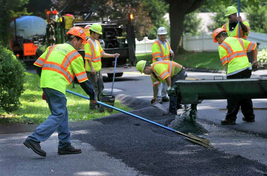 For the second time in three years, Connecticut municipalities have not received state funding for scheduled summer road repaving work. Photo: File Photo / The News-Times