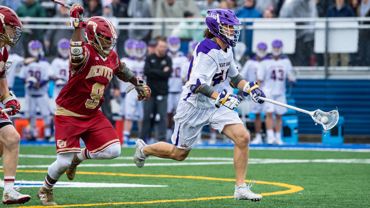 UAlbany's Kyle McClancy sprints past Denver's Trevor Baptiste on his way to a goal in an NCAA Tournament quarterfinal in 2018. McClancy has signed with the Albany FireWolves of the National Lacrosse League.