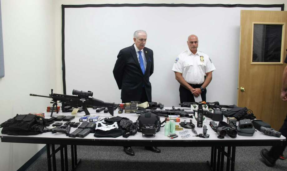 Westchester County District Attorney Anthony Scarpino, left, and Tuckahoe Village Police Chief John Constanzo review a cache of weapons seized in the Westchester County community at a press conference Wednesday. Photo: / Contributed