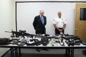 Westchester County District Attorney Anthony Scarpino, left, and Tuckahoe Village Police Chief John Constanzo review a cache of weapons seized in the Westchester County community at a press conference Wednesday.