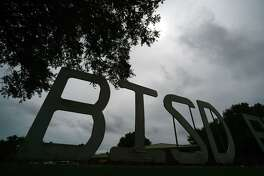 The BISD sign in front of the school district's administration building is partially silhouetted against a cloudy sky Tuesday afternoon. The Beaumont Independent School District board of trustees will soon be replaced by a board of managers installed by Texas Education Commissioner Michael Williams. Photo taken Tuesday 7/15/14 Jake Daniels/@JakeD_in_SETX