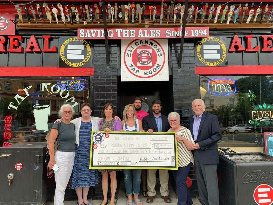 The 10th annual Eli Cannons Charitable Beer Fest Aug. 5 in Middletown raised a record-breaking $18,449 for the Coalition on Housing and Homelessness. From left are Lydia Brewster of St. Vincent de Paul Middletown, Maryellen Shuckerow, coalition Director Ann Faust, owners Aubrey and Rocco LaMonica, Mayor Dan Drew, Patti Anne Vassia and Middlesex County Chamber of Commerce President Larry McHugh. Photo: Contributed Photo