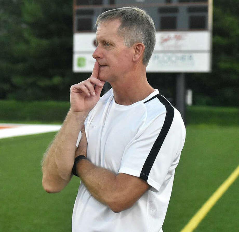 Edwardsville coach Mark Heiderscheid watches Monday's scrimmage from the sideline inside the District 7 Sports Complex. Photo: Matt Kamp|The Intelligencer