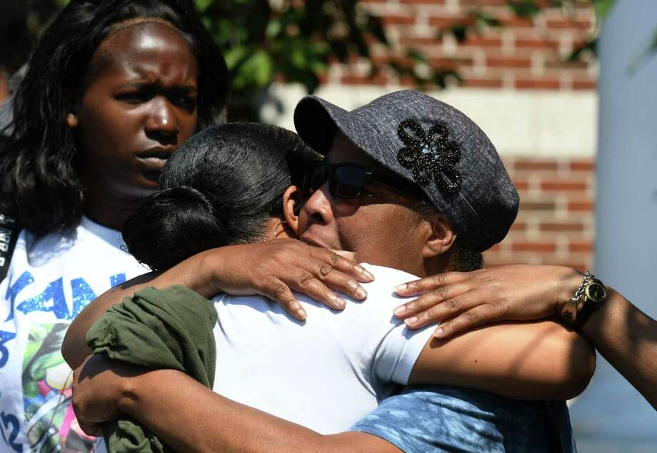Charisse Sellie, mother of Ayanna Hunter, left, is consoled by a family member following a news conference where Schenectady County District Attorney Robert Carney  stated that the men who fatally shot Ayanna Hunter in May acted in self-defense and will not face homicide charges on Thursday, Aug. 15, 2019, at Niskayuna Town Hall in Niskayuna, N.Y. (Will Waldron/Times Union) Photo: Will Waldron, Albany Times Union / 20047662A