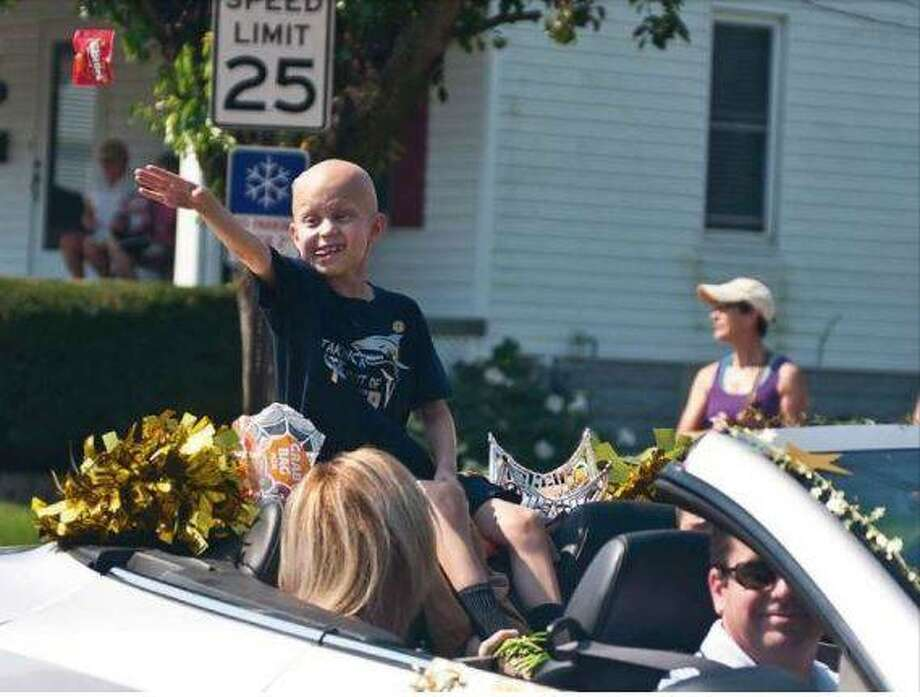 Jonny Wade tosses candy in September 2015 while performing his duties as that year's grand marshal in the Bethalto Labor Day Parade.
