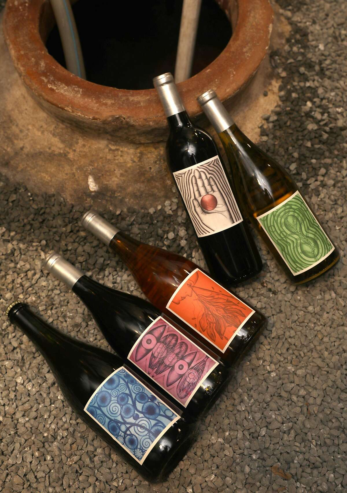 Winemaker Caleb Leisure made five different wines from 2018 which he shows here at Coturri Wine on Tuesday, Aug. 13, 2019, in Glen Ellen, Calif. Bottom to top�2018 Caesura, 2018 Ab Ovo, 2018 Mother Knows, 2018 Other Hand, and 2018 Verso.