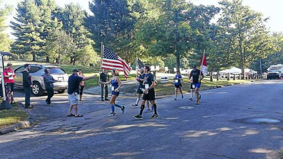 Runners return from a five-mile loop during a past Run for the Fallen at Veterans Park in Middletown. Photo: Hearst Connecticut Media File Photo