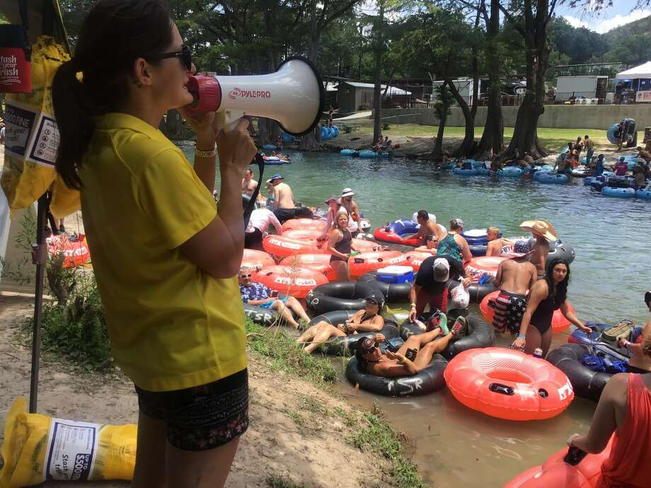 Holley Hood speaks with tubers through a megaphone about the Water Oriented Recreation District of Comal County grass-roots anti-littering campaign.  Photo: Water Oriented Recreation District Of Comal County