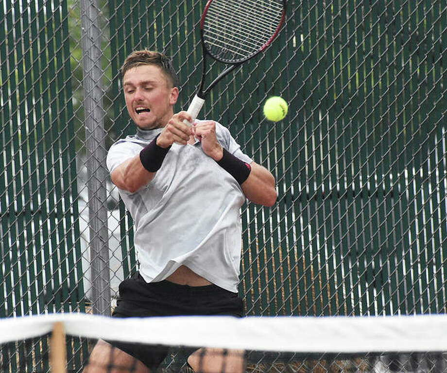 Nathan Ponwith slams a forehand shot during the first set of the final of the Edwardsville Futures tennis tournament.