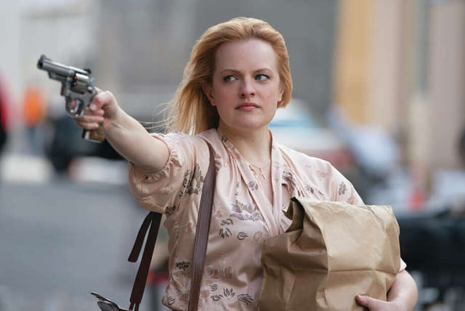 "Elisabeth Moss in a scene from ""The Kitchen."" Photo: (Alison Cohen Rosa/Warner Bros. Photo Via AP)"