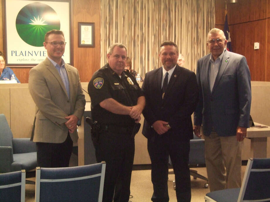 Plainview Police Lieutenant William Bridgwater is recognized Tuesday evening for his recent completion of the Leadership Command College – Class 84 of the Law Enforcement Management Institute of Texas. (L-R) City Manager Jeffrey Snyder, Police Chief Ken Coughlin, Lt. Bridgwater and Mayor Wendell Dunlap. Photo: Deborah Zacher/For The Herald